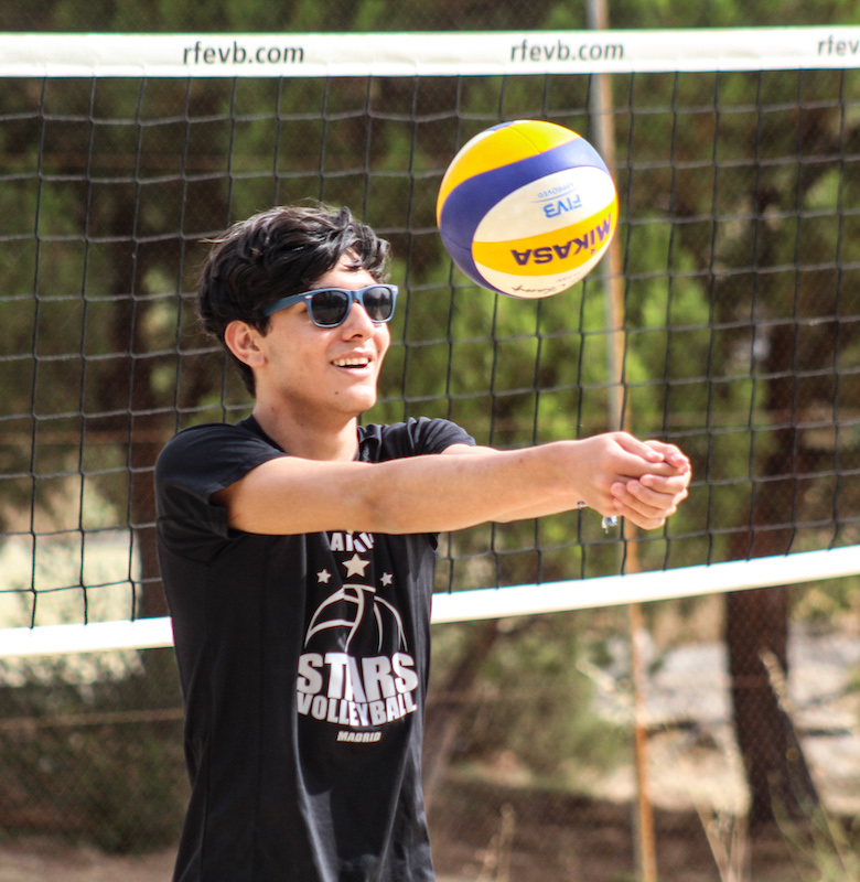 Toque de brazos voley playa